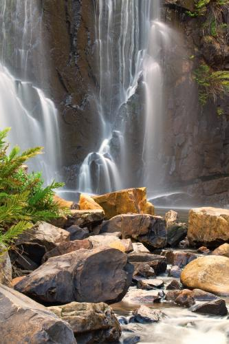 Waterfall with rocks in foreground