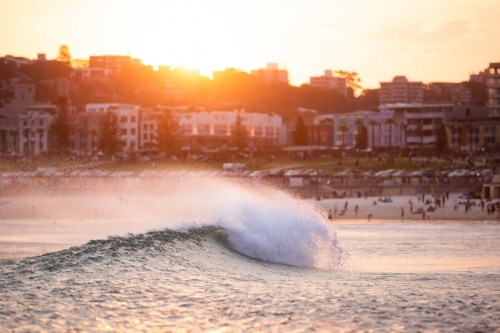 Wave crashing at sunset at Bondi Beach