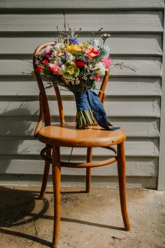 wedding bouquet on a chair.