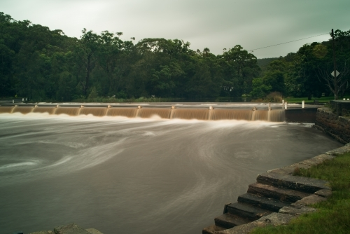 Weir and river in flood