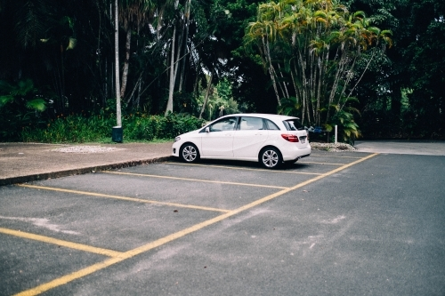 White car parked in empty car park