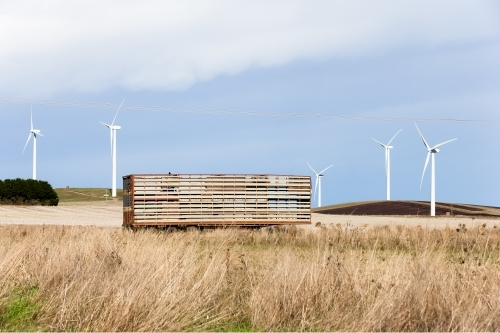 Truck carriage with wind farm in background