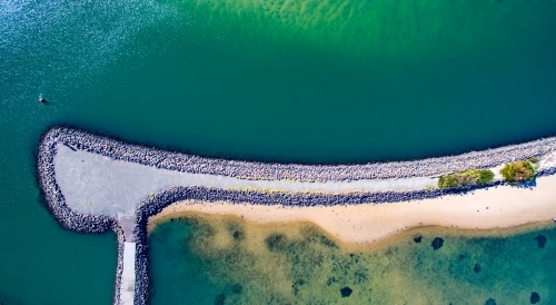 Abstract aerial view of a breakwater structure on Lake Illawarra