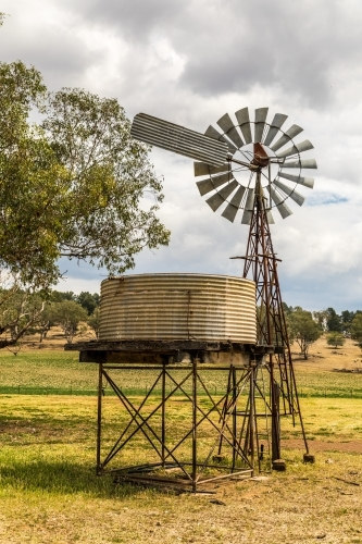 Windpump (windmill) and water tank on a dry farmland property