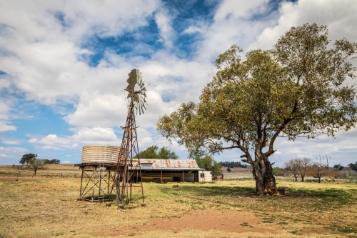Windpump (windmill), water tank and haystack barn on a dry farmland property