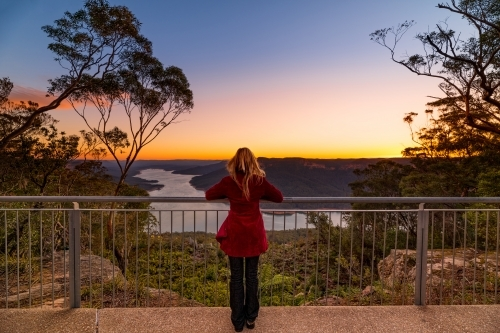 Woman at lookout watching the sunset at Burragorang, Nattai Australia