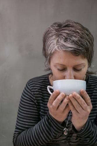 Woman drinking first coffee of the day