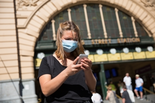 Woman in Face Mask Waiting at Flinders Street Station