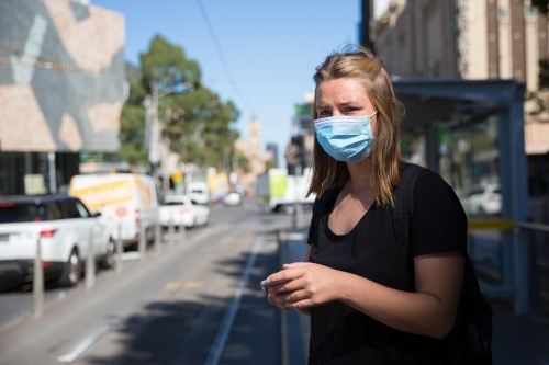 Woman in Face Mask Waiting for Public Transport