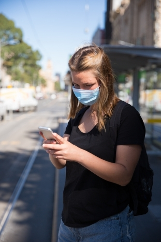 Woman in Face Mask Waiting for Transport