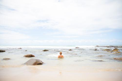 Woman soaking in the waves at Boomerang Beach