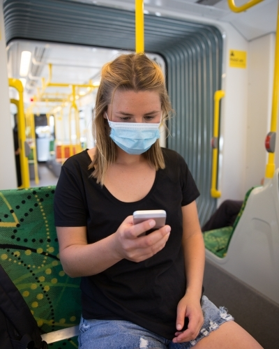 Woman Wearing Face Mask Travelling on Tram