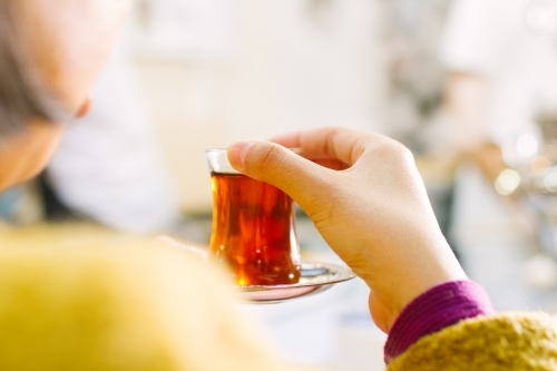 Women drinking turkish tea at markets