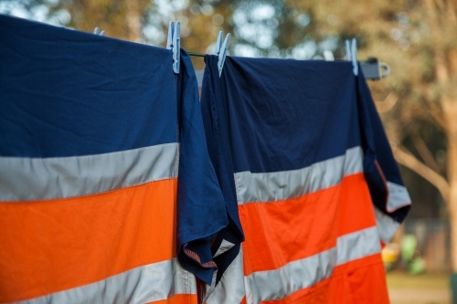 Orange reflective work clothing hanging on the line
