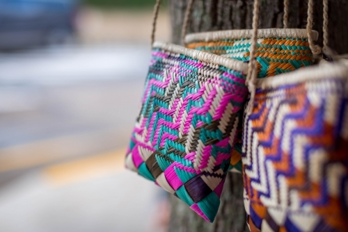 Woven straw bags on tree