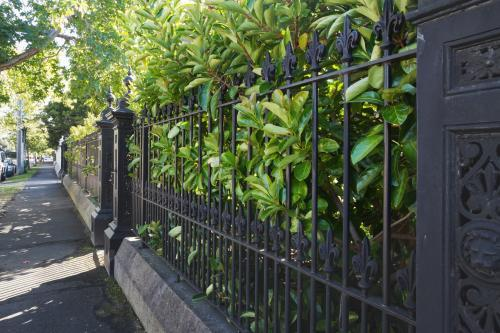 Wrought iron fence and footpath in exclusive Melbourne suburb