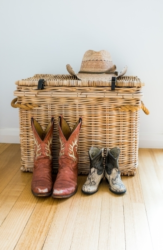 Cowgirl mum and cowboy baby boots waiting to be worn