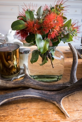 A vase of fresh picked New Zealand Christmas Bush on a coffee table