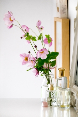 Table scape of flowers and perfume bottles