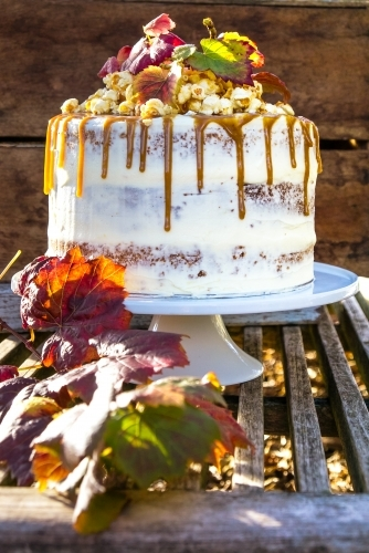 Autumn styled layer cake with caramel drizzle and popcorn