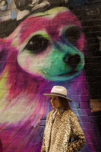 Hip young girl with street art in Hosier lane