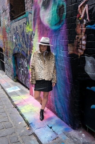 Hip young girl with street art in Hosier lane Melbourne