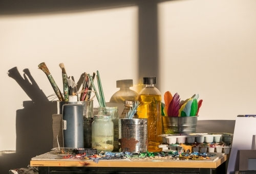 Morning light in an art studio with brushes and paint palette