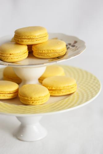Yellow macarons on cake stand