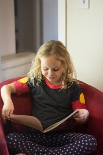 Young Aboriginal girl reading