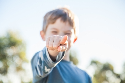 Young Aussie kid pointing a finger at the camera