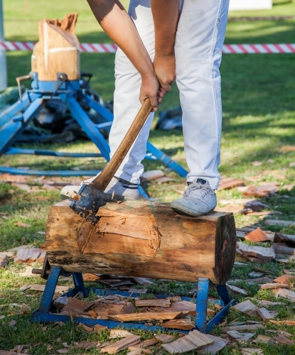 Young axeman competing in a woodchop competition