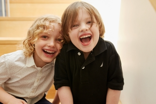 Young boy and girl smiling for camera