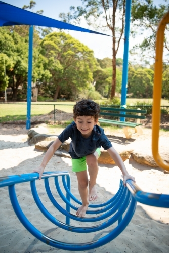 Young boy playing at outdoor playground