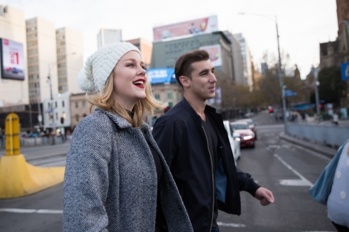 Young Couple Crossing the Road in Melbourne City