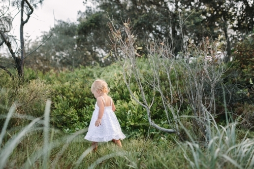 Young girl exploring in the bush