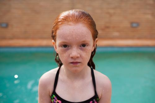Young girl looking serious after a swim