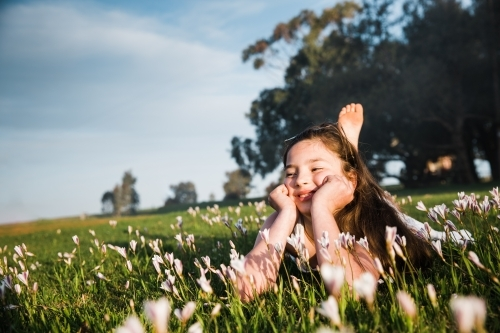 Young girl lying in field of flowers