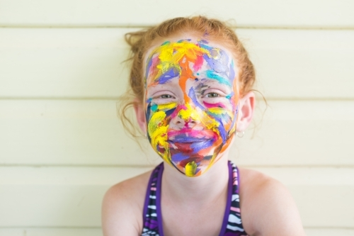 Young girl with a brightly painted face