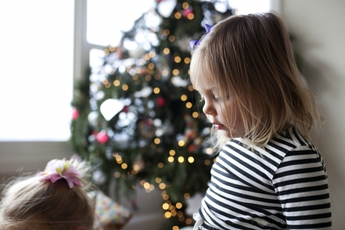 Young girls in front of Christmas tree