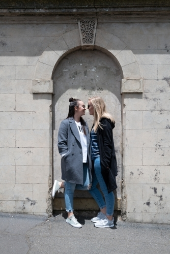 Young lesbian couple kissing