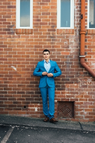 young man in blue suit