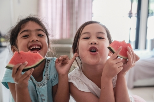 Young multicultural girls having watermelon in summer