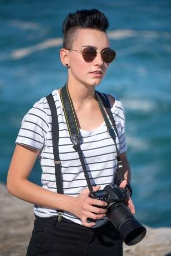 Young photographer with sunglasses