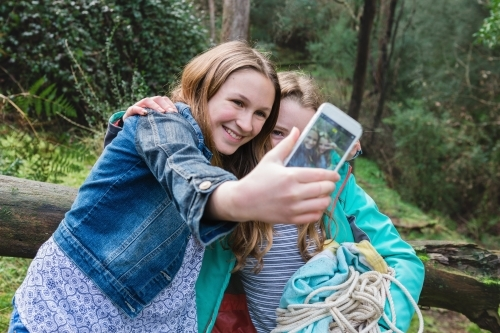 young teen girls take a selfie together