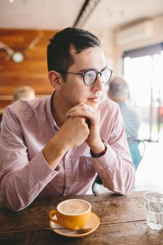 Young well dressed male with coffee in a cafe