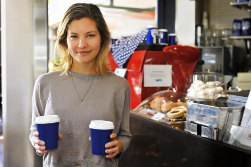 young woman buying takeaway coffees at a cafe