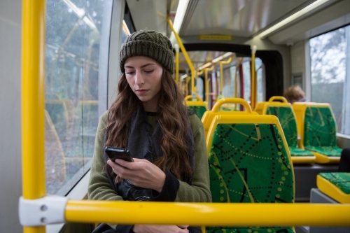 Young Woman Riding the Tram