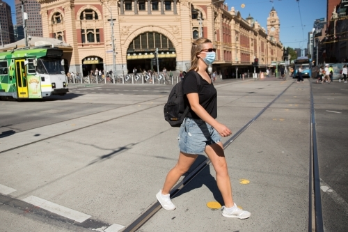 Young Woman Wearing Face Mask in Downtown Melbourne