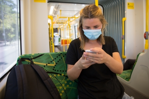 Young Woman Wearing Face Mask on Tram